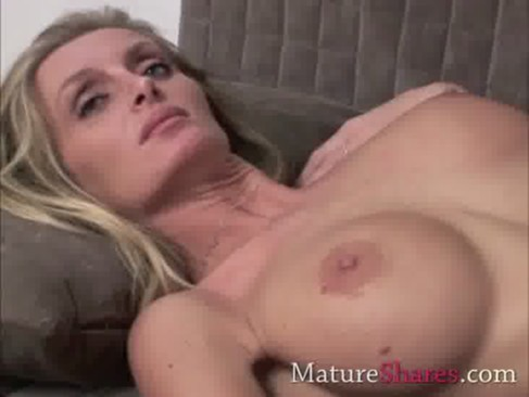 Skinny blonde MILF showing her toy